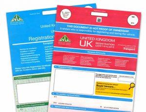 Red and blue V5C Vehicle Registration Log Books