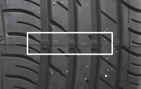 Tyre tread depth level indicators located within the grooves of the tyre tread